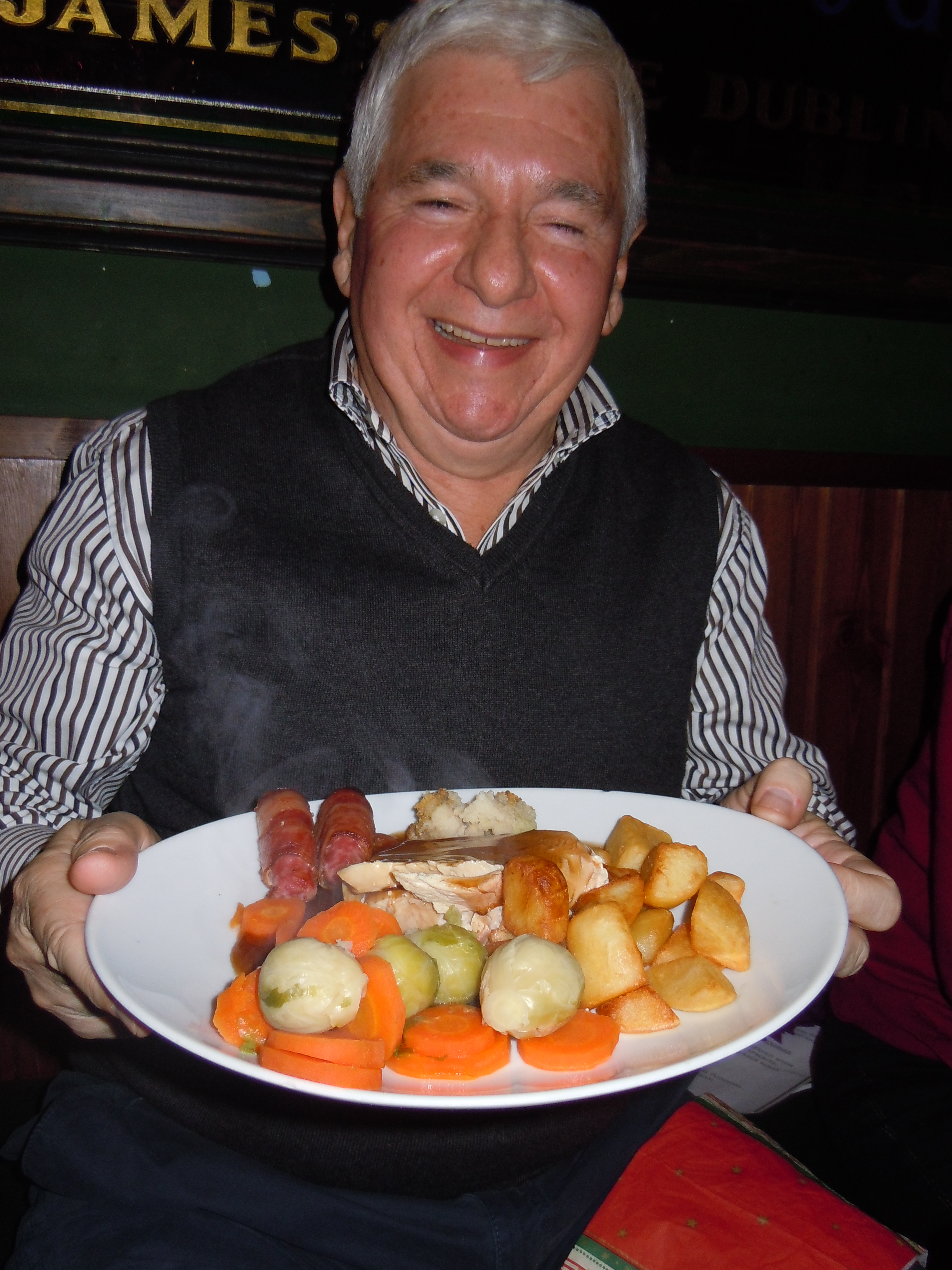 A traditional English Christmas dinner of roast turkey, sausages in bacon, roast potatoes, brussels sprouts, carrots, stuffing, gravy and cranberry sauce!!!